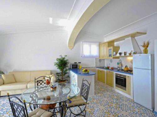 A kitchen or kitchenette at Gorgeous Holiday Home in Praia with a Breathtaking Seaview