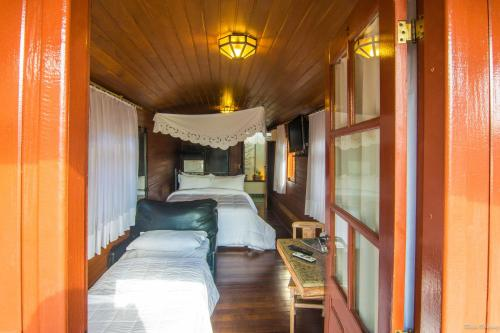Cama ou camas em um quarto em Pousada Trem do Imperador
