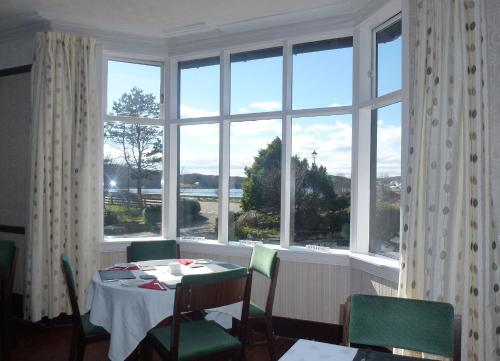A restaurant or other place to eat at Arisaig Hotel