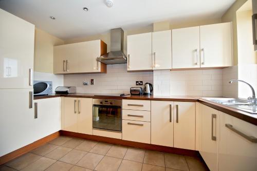 A kitchen or kitchenette at Staycity Aparthotels Saint Augustine Street