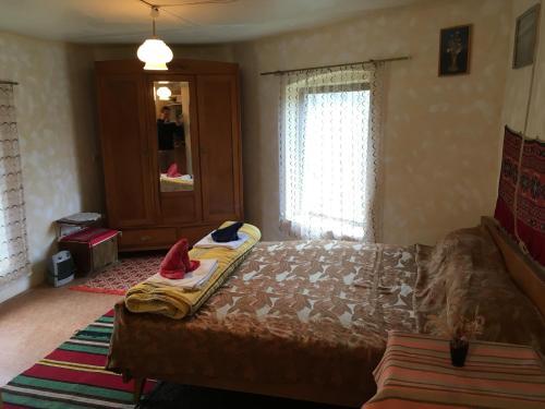 A bed or beds in a room at Art Villa Orlova Chuka