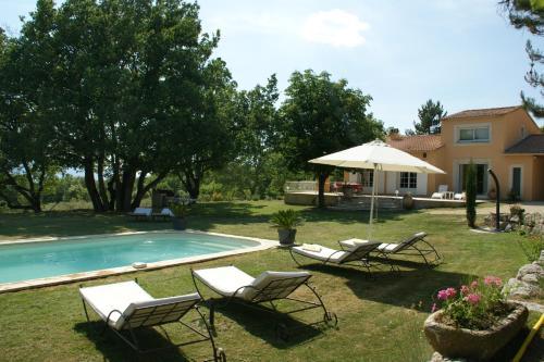 The swimming pool at or near Villa Le Grand Chene