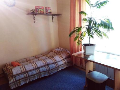 Кровать или кровати в номере Абажур