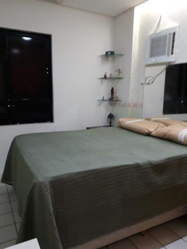 A bed or beds in a room at Flat Passo das Águas