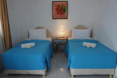 A bed or beds in a room at At The Beach Candidasa