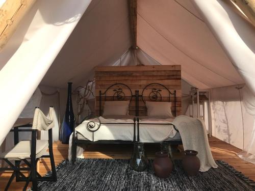 Cama o camas de una habitación en Plage Cachée - Glamping
