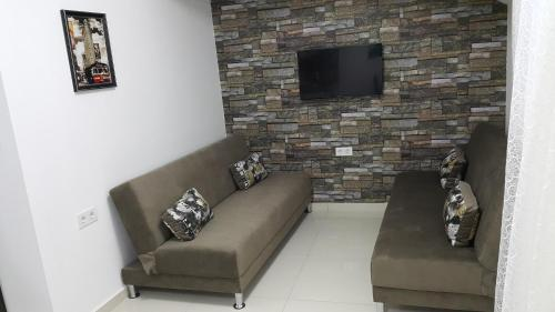 A seating area at IMC Fatih Apartments