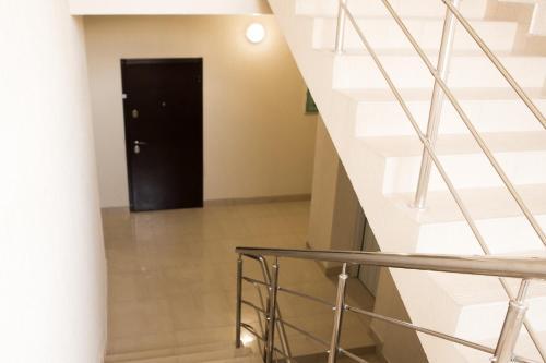 Телевизор и/или развлекательный центр в Апартаменты Олимпийская студия