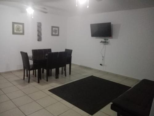 A television and/or entertainment center at MV Suites Suc. Capilla