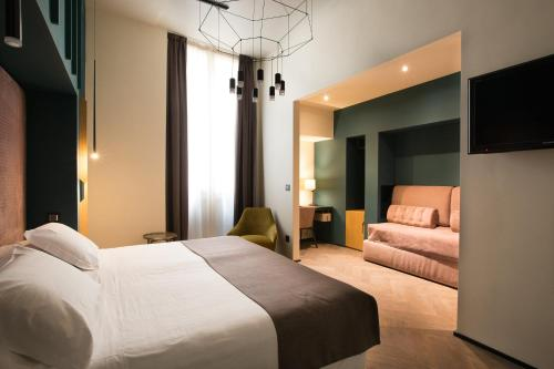 Letto o letti in una camera di Hotel Silla