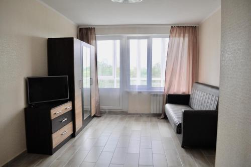 A television and/or entertainment center at DailyRent Moskovsky