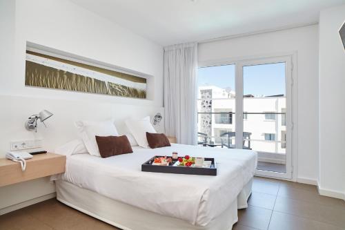 Cama o camas de una habitación en Ibiza Sun Apartments