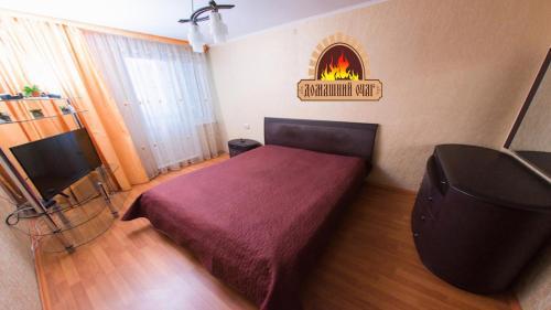 Кровать или кровати в номере City Center Apartment Чкалова 59