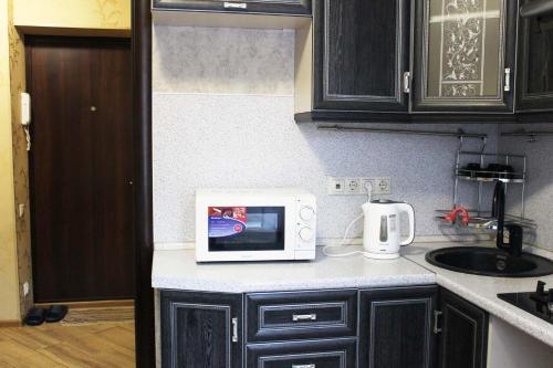 Кухня или мини-кухня в DearHome Prospect Lenina