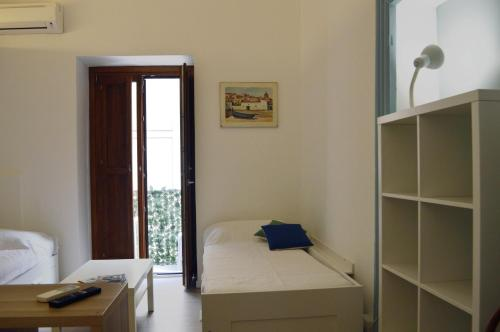 A bed or beds in a room at I Colori al Mare