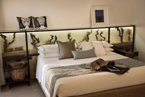 Letto o letti in una camera di Riofavara Suites