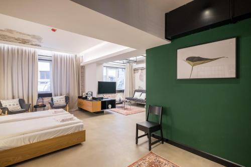 A television and/or entertainment centre at R34 Boutique Hotel