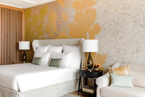 A bed or beds in a room at Royal Champagne Hotel & Spa