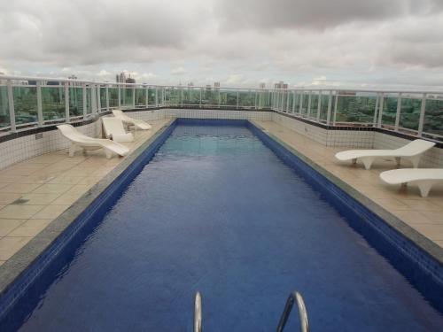 The swimming pool at or close to Studio Iracema Temporada Aconchegante