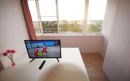 A television and/or entertainment center at Business Apartment Vologda Center