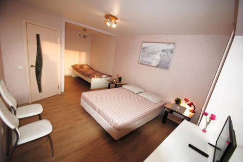 Кровать или кровати в номере Business Apartment Vologda Center