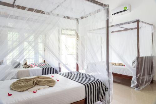 Ein Bett oder Betten in einem Zimmer der Unterkunft Sigiriya Sun Shine Villa
