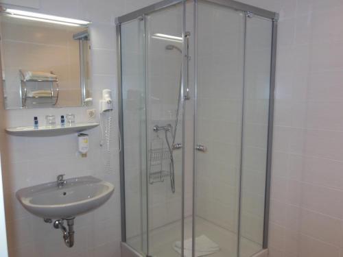 Ein Badezimmer in der Unterkunft Hotel Asterra