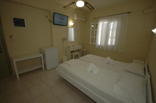 Ένα ή περισσότερα κρεβάτια σε δωμάτιο στο Pension Ocean View