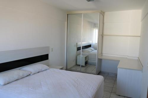 A bed or beds in a room at Flat Cezar's Park