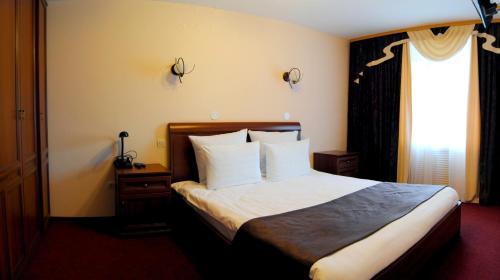 Кровать или кровати в номере Гостиница Воздушная Гавань