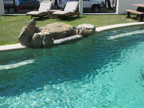 The swimming pool at or near Trinity Beach House