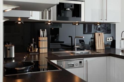 A kitchen or kitchenette at Luxoise Apartments
