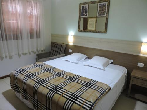 A bed or beds in a room at Hotel Missões