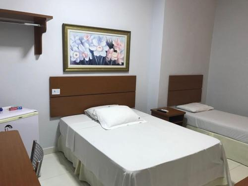 A bed or beds in a room at Hotel Itamarati