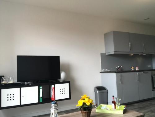 Een TV en/of entertainmentcenter bij Gerbrandion Appartement Verhuur
