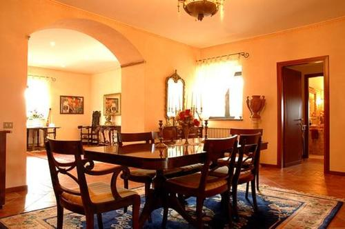 A restaurant or other place to eat at Relais Poggio Del Sogno
