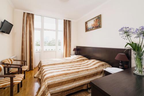 Кровать или кровати в номере Санаторий Светлана