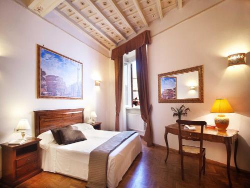 Letto o letti in una camera di Pantheon Inn