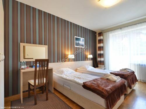 Łóżko lub łóżka w pokoju w obiekcie Ośrodek Wczasowy Paradise