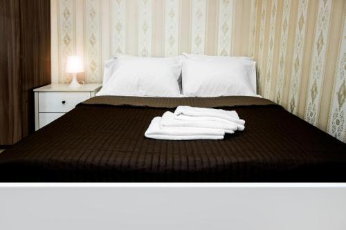 Кровать или кровати в номере Apatment Orshanskay 2