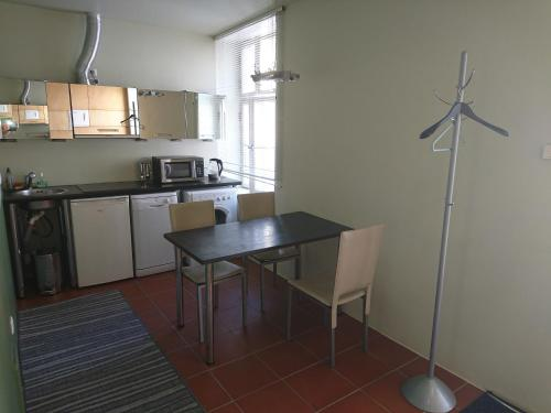 A kitchen or kitchenette at Aaba Apartment