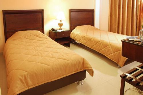 A bed or beds in a room at Jardaneh Hotel