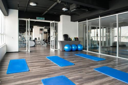 The fitness centre and/or fitness facilities at Olive Tree Hotel Penang