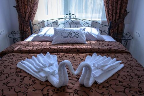 Кровать или кровати в номере Guest House KDV