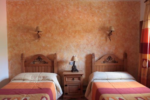 A bed or beds in a room at El Mirador de Riópar Viejo