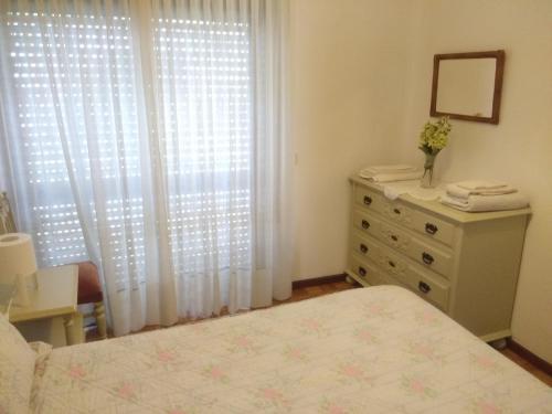 Uma cama ou camas num quarto em Apartamento Soares