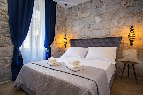A bed or beds in a room at Best4Stay Luxury Rooms