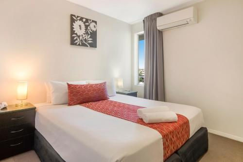 A bed or beds in a room at The Chermside Apartments