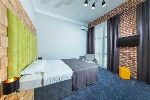 Кровать или кровати в номере BETON BRUT All Inclusive & Spa Hotel in Miracleon