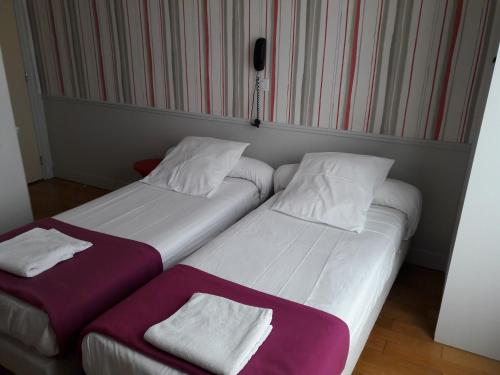 A bed or beds in a room at Perfect Hotel & Hostel